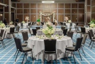 Wedding tables set up in ballroom